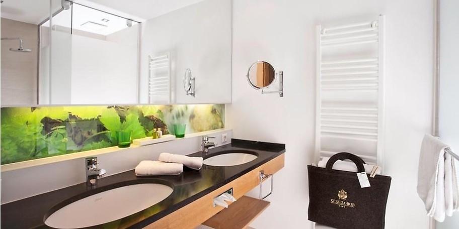 Im gemütlichen Bad Ihrer Suite können Sie die Seele baumeln lassen