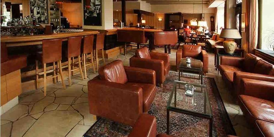 Entspannen Sie in der Bar bei einem guten Drink
